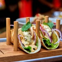 traditional-street-mexican-pork-tacos-with-beef-tomatoes-avocado-chilli-onions-yellow-corn-tortilla-called-al-pastor_334698-319
